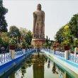 Фото Статуя стоящего Будды в Варанаси 9